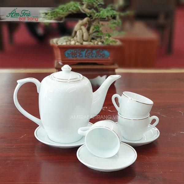 Bộ trà chỉ vàng sứ trắng dáng trống